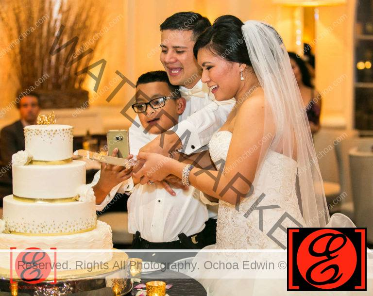 bride and groom with son cutting cake