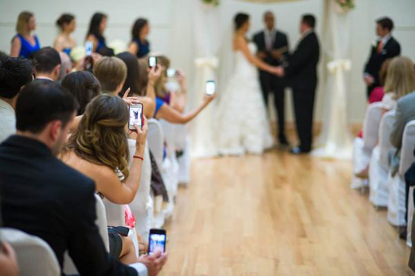 wedding guest taking photos phone
