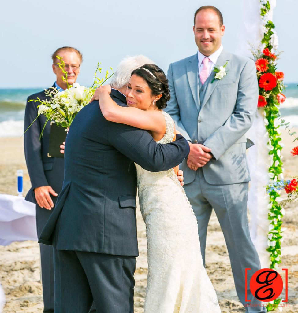 bride hugging father on her wedding ceremony avalon beach wedding